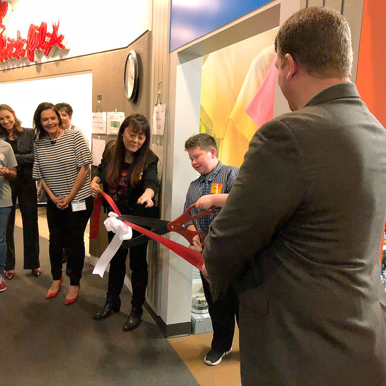 Students join JA, civic leaders and Walmart representatives in the opening and ribbon cutting of two new educational storefronts at Auburn's JA World on Oct. 5. COURTESY PHOTO